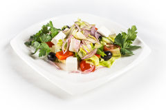 Greek Salad. With cheese and greens on white plate Royalty Free Stock Photos
