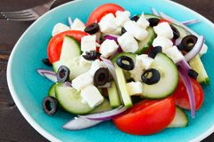 Greek Salad close up on a blue plate Royalty Free Stock Photography