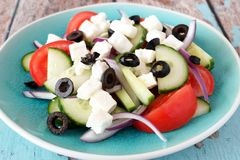 Greek Salad close up on a blue plate Royalty Free Stock Image