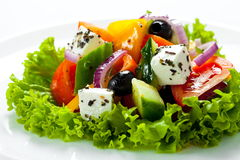 Greek salad close up on white background Stock Photos