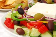 Greek salad closeup. Closeup of a Greek salad served with garlic bread stock photos