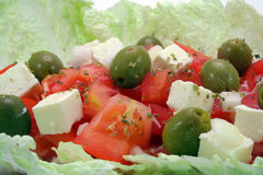 Greek salad closeup. Greek salad with olives, tomatos and cheese Stock Photos