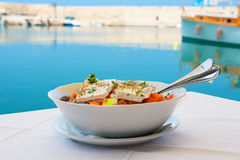 Greek salad. Crete. Greek salad with feta cheese on table. Rethymno, Crete, Greece Royalty Free Stock Photography