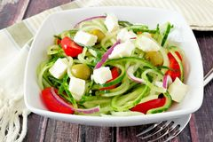 Greek Salad with cucumber noodles in white bowl Royalty Free Stock Images