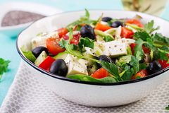 Greek salad with cucumber, tomato, sweet pepper, lettuce, green onion. Greek salad  with cucumber, tomato, sweet pepper, lettuce, green onion, feta cheese and stock image