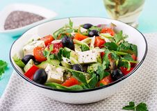 Greek salad with cucumber, tomato, sweet pepper, lettuce, green onion. Greek salad  with cucumber, tomato, sweet pepper, lettuce, green onion, feta cheese and royalty free stock photos