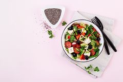 Greek salad with cucumber, tomato, sweet pepper, lettuce, green onion, feta cheese. Greek salad  with cucumber, tomato, sweet pepper, lettuce, green onion, feta stock photo