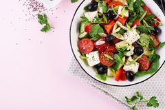 Greek salad with cucumber, tomato, sweet pepper, lettuce, green onion, feta cheese. Greek salad  with cucumber, tomato, sweet pepper, lettuce, green onion, feta royalty free stock photos