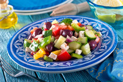 Greek Salad. A delicious greek salad with feta cheese, kalamata olives, cucumber, peppers, onion, and tomato Stock Photo