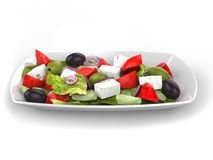 Greek salad dish. Isolated on white background Stock Photography