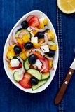 Greek salad. With feta cheese, olives and vegetables Stock Photo