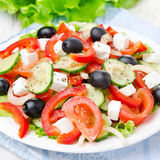 Greek salad with feta cheese, olives and vegetables, close-up Stock Images