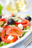 Greek salad with feta cheese, olives and vegetables, close-up Royalty Free Stock Images