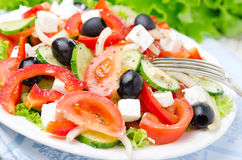 Greek salad with feta cheese, olives and vegetables, horizontal Stock Images