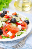 Greek salad with feta cheese, olives and vegetables Stock Photos