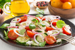 Greek salad with feta cheese on a plate Stock Image