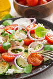 Greek salad with feta cheese on a plate, close-up Royalty Free Stock Photography