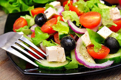Greek salad and fork Royalty Free Stock Photos