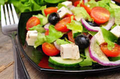 Greek salad and fork Royalty Free Stock Images