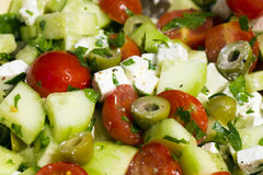 Greek salad. Fresh Greek salad with tomato, cucumber, feta cheese and olives Royalty Free Stock Photography