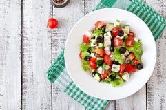 Greek salad with fresh vegetables Stock Images