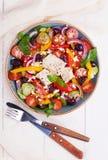Greek salad with fresh vegetables, feta cheese, black olives Stock Photos