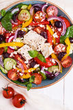 Greek salad with fresh vegetables, feta cheese, black olives Royalty Free Stock Image