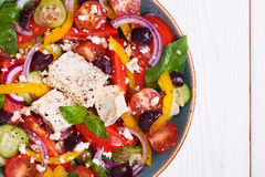 Greek salad with fresh vegetables, feta cheese, black olives Stock Photography