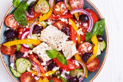 Greek salad with fresh vegetables, feta cheese, black olives Royalty Free Stock Photo
