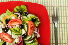 Greek salad with fresh vegetables, feta cheese and Stock Photos