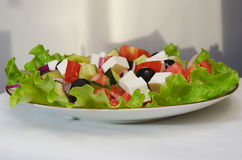 GREEK SALAD. With fresh vegetables, feta cheese and black olives Stock Photos