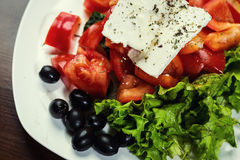 Greek salad with fresh vegetables, feta cheese and black olives, Royalty Free Stock Photography