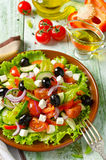 Greek salad with fresh vegetables, feta cheese and black olives Royalty Free Stock Images