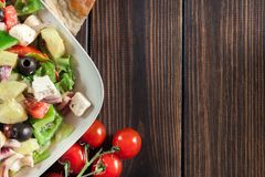 Greek salad with fresh vegetables Stock Photos