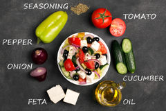 Greek salad with fresh vegetables, feta cheese and black olives. Top view Royalty Free Stock Photos