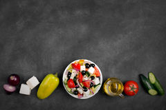 Greek salad with fresh vegetables, feta cheese and black olives. Top view Royalty Free Stock Image