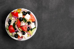 Greek salad with fresh vegetables, feta cheese and black olives. Top view Stock Photo