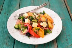 Greek salad with fresh vegetables and feta cheese in large white Stock Photo