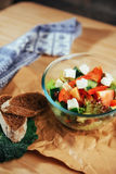 Greek salad with fresh vegetables, feta cheese and olives Stock Photos