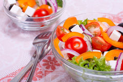 Greek salad. With fresh vegetables on the table in transparent salad bowl Stock Image