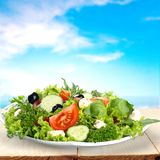 Greek salad with fresh vegetables on wooden table royalty free stock photography