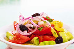 Greek salad in front of Mediterranean sea Royalty Free Stock Photography