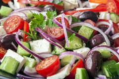 Greek Salad Full Frame. Greek salad in full frame.  Black olives, feta cheese, cucumber, cherry tomatoes, red onions and herbs Royalty Free Stock Image