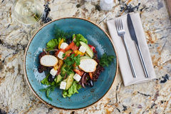Greek salad with giant olives and provencal herbs Royalty Free Stock Image