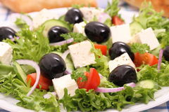 Greek salad with gigantic black olives, sheeps cheese Stock Photography
