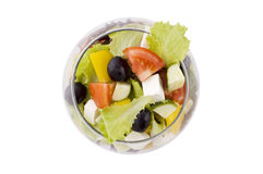 Greek salad in glass bowl Stock Photos