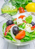 Greek salad in a glass bowl. Closeup Royalty Free Stock Photography
