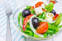 Greek salad in a glass bowl Stock Photos