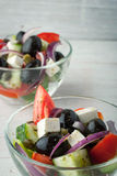 Greek salad in the glass dish vertical Royalty Free Stock Images