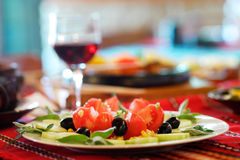 Greek salad and glass of red wine Royalty Free Stock Image